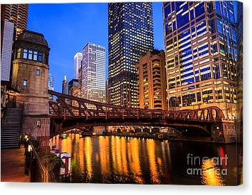 Chicago At Night At Clark Street Bridge Canvas Print by Paul Velgos