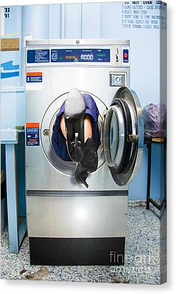 Cleaning Lady Trapped In Washing Machine Canvas Print by Jorgo Photography - Wall Art Gallery