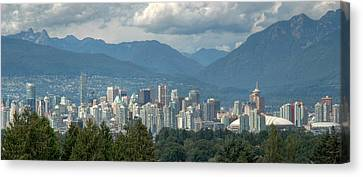 Distant View Of Vancouver British Columbia. Canvas Print by Rob Huntley