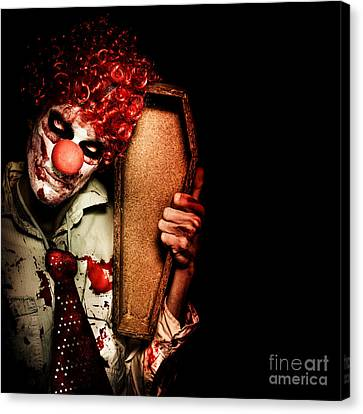 Evil Horrible Clown Holding Coffin In Darkness Canvas Print by Jorgo Photography - Wall Art Gallery