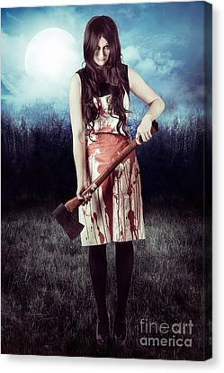 Evil Woman Standing In Dark Field Carrying Axe Canvas Print by Jorgo Photography - Wall Art Gallery