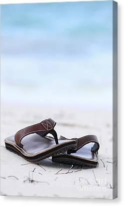 Flip-flops On Beach Canvas Print by Elena Elisseeva