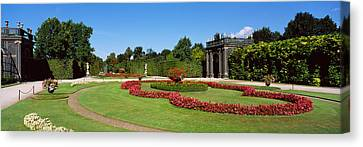 Formal Garden In Front Of A Building Canvas Print by Panoramic Images