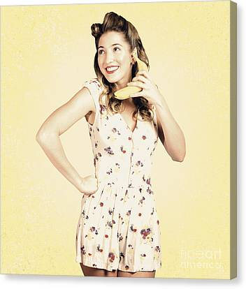 Funny Pin-up Model In Conversation On Banana Phone Canvas Print by Jorgo Photography - Wall Art Gallery