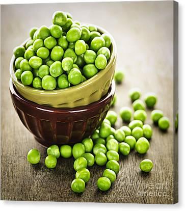 Green Peas Canvas Print by Elena Elisseeva