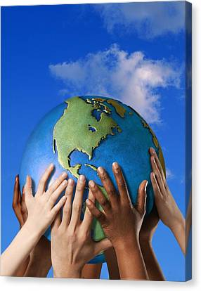 Hands On A Globe Canvas Print by Don Hammond