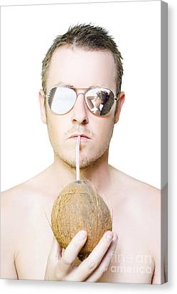 Handsome Summer Man Drinking Coconut Cocktail Canvas Print by Jorgo Photography - Wall Art Gallery