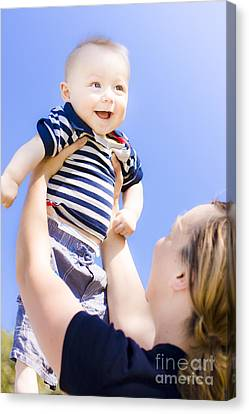 Happy Baby Held Up To The Sky Canvas Print by Jorgo Photography - Wall Art Gallery