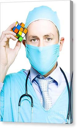 Healthcare Practitioner With A Medical Puzzle Canvas Print by Jorgo Photography - Wall Art Gallery