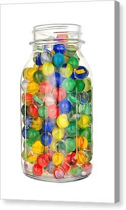 Jar Of Marbles Canvas Print by Jim Hughes