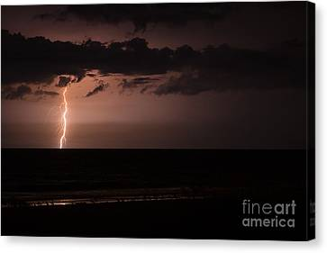 Lightning Over The Ocean Canvas Print by Dawna  Moore Photography