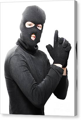 Male Criminal In Mask Making A Hand Gun Gesture Canvas Print by Jorgo Photography - Wall Art Gallery
