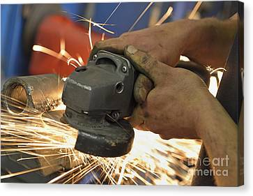 Man Cutting Steel With Grinder Canvas Print by Sami Sarkis