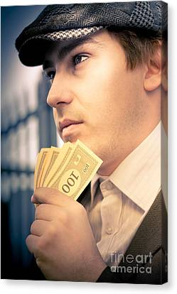 Man Holding Money Making A Financial Decision Canvas Print by Jorgo Photography - Wall Art Gallery