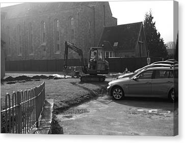 Man Using A Volvo Excavator In Front Of Vehicles In Scotland Canvas Print by Ashish Agarwal