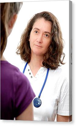 Medical Consultation With Teenage Girl Canvas Print by Aj Photo