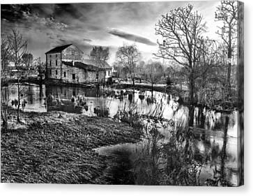 Mill By The River Canvas Print by Jaroslaw Grudzinski