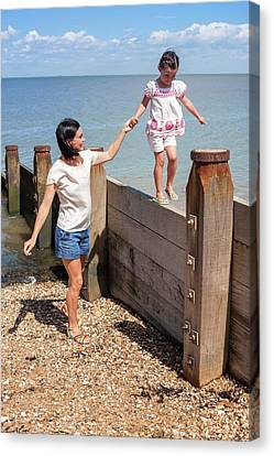 Mother And Daughter On Beach Canvas Print by Ian Hooton