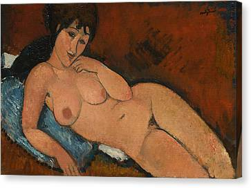 Nude On A Blue Cushion Canvas Print by Amedeo Modigliani