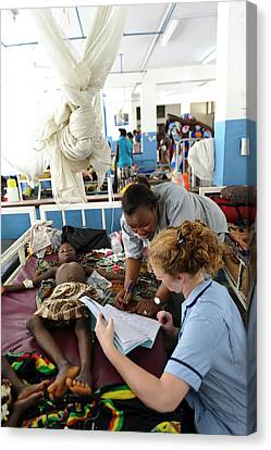 Paediatric Nursing In Sierra Leone Canvas Print by Matthew Oldfield
