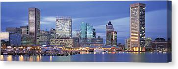Panoramic View Of An Urban Skyline At Canvas Print by Panoramic Images