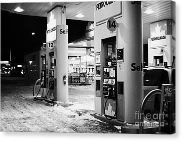 petro canada winter gas fuel pump at service station Regina Saskatchewan Canada Canvas Print by Joe Fox