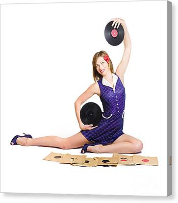 Pin-up Woman Balancing Sound With Record Music Canvas Print by Jorgo Photography - Wall Art Gallery