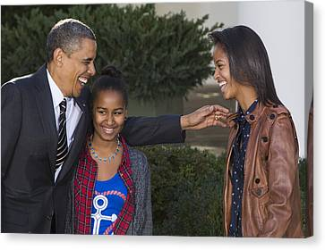 President Obama And Daughters Canvas Print by JP Tripp