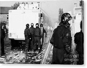 Psni Riot Officers Behind Water Canon During Rioting On Crumlin Road At Ardoyne Shops Belfast 12th J Canvas Print by Joe Fox