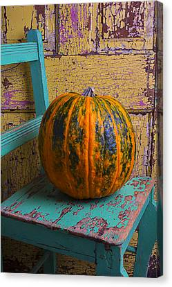 Pumpkin On Green Chair Canvas Print by Garry Gay
