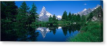 Reflection Of A Snow Covered Mountain Canvas Print by Panoramic Images