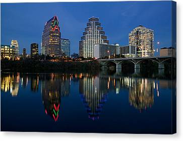 Reflection Of Buildings In Water, Town Canvas Print by Panoramic Images