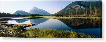 Reflection Of Mountains In Water Canvas Print by Panoramic Images