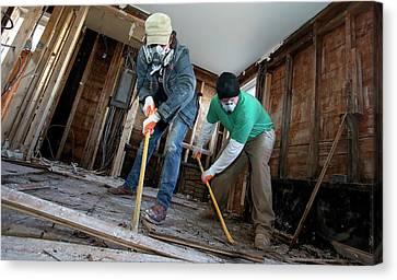 Repairing Hurricane Sandy Damage Canvas Print by Jim West