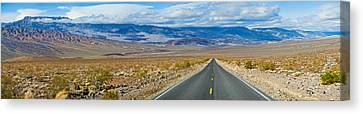 Road Passing Through A Desert, Death Canvas Print by Panoramic Images