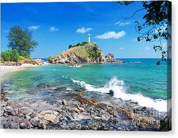 Rock Sea And Sky Canvas Print by Atiketta Sangasaeng
