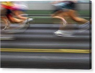Runners Blurred Canvas Print by Jim Corwin