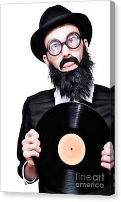 Sixties Retro Rock Man Holding Music Record Vinyl Canvas Print by Jorgo Photography - Wall Art Gallery
