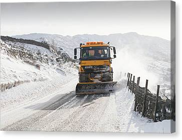 Snow Plough At Work Canvas Print by Ashley Cooper