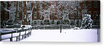 Snowcapped Benches In A Park Canvas Print by Panoramic Images