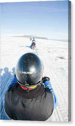 Snowmobilers Canvas Print by Ashley Cooper