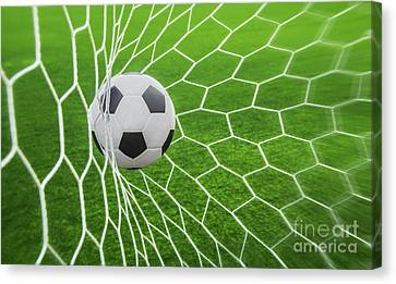 Soccer Ball In Goal  Canvas Print by Anek Suwannaphoom