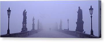 Statues And Lampposts On A Bridge Canvas Print by Panoramic Images