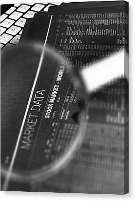Stock Market Figures And Magnifying Glass Canvas Print by Tek Image