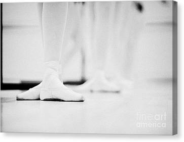 Students With Feet In The Third Position At A Ballet School In The Uk Canvas Print by Joe Fox