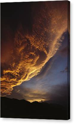Sunset On Storm Clouds Near Mt Cook Canvas Print by Ian Whitehouse