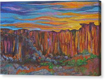 Sunset Over The Canyon Canvas Print by Kathy Peltomaa Lewis