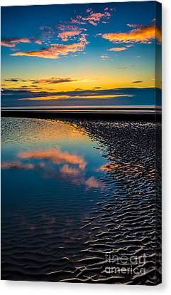 Sunset Reflections Canvas Print by Adrian Evans
