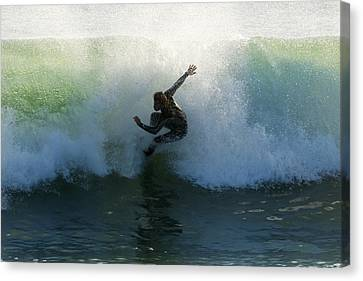 Surfer Catching A Wave Canvas Print by Ben Welsh
