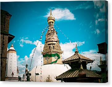 Swayambhunath Stupa In Nepal Canvas Print by Raimond Klavins